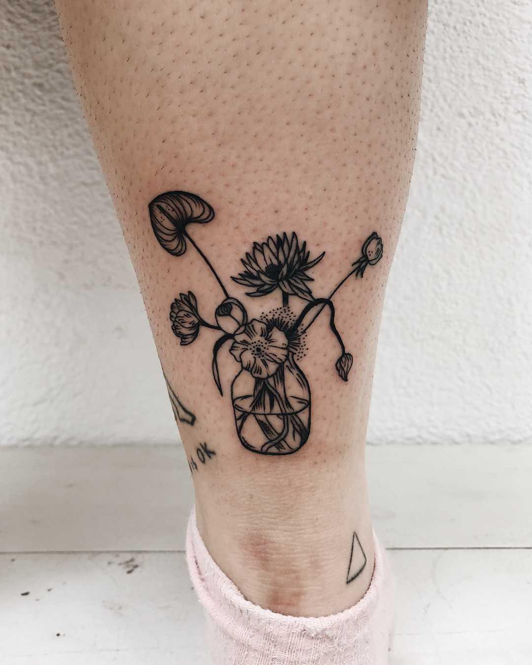 Flowers in a jug tattoo