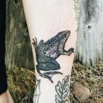 Frog tattoo on the shin
