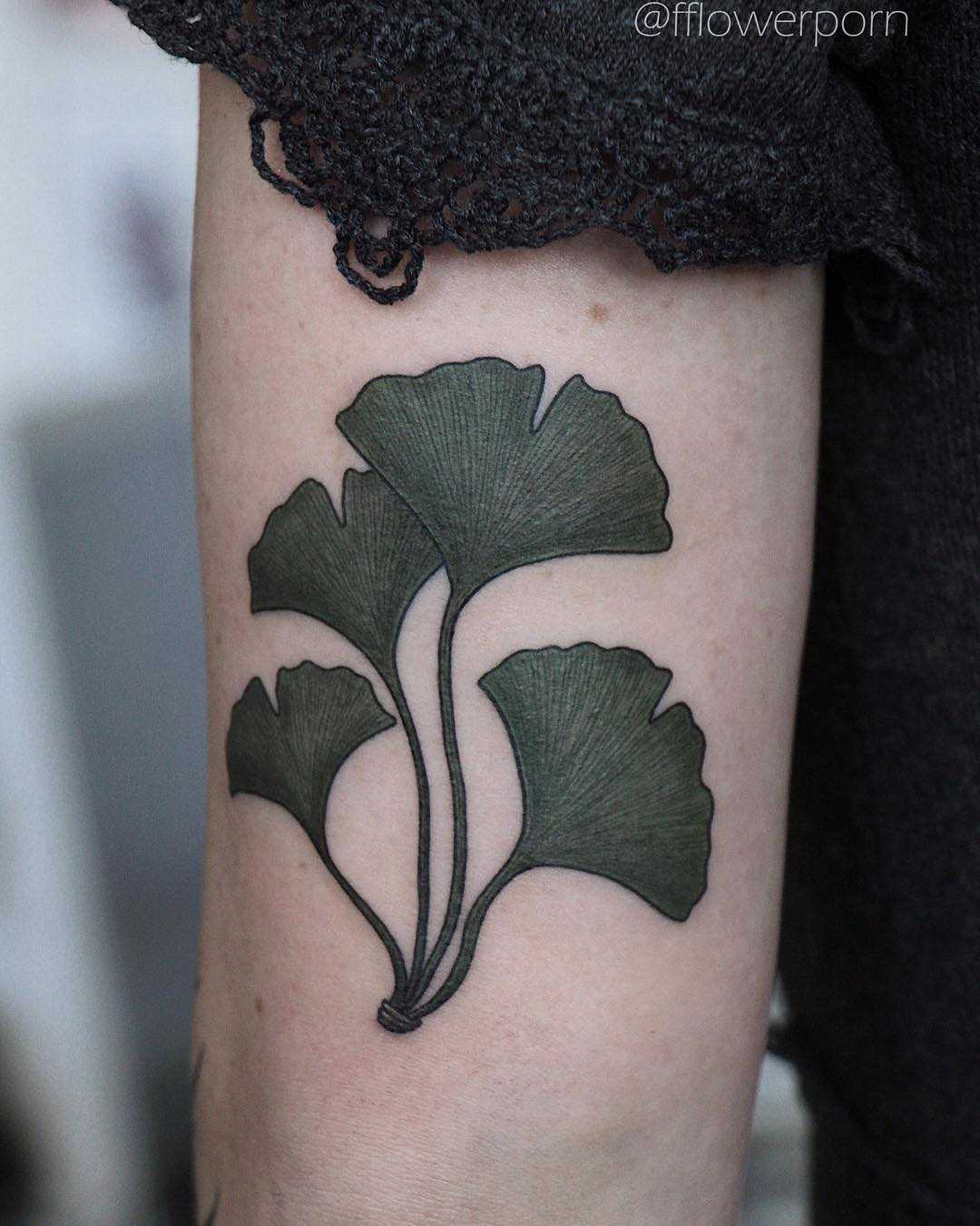 Ginkgo leaves tattoo on the arm