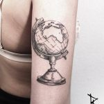 Globe tattoo on the triceps by Loïc Lebeuf