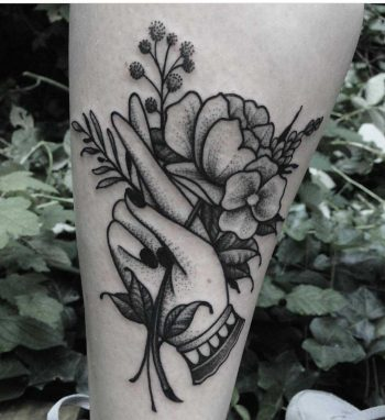 Hand with flower by Roald Vd Broek