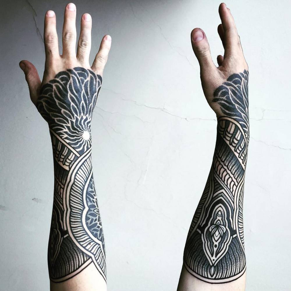 Henna inspired forearm tattoo