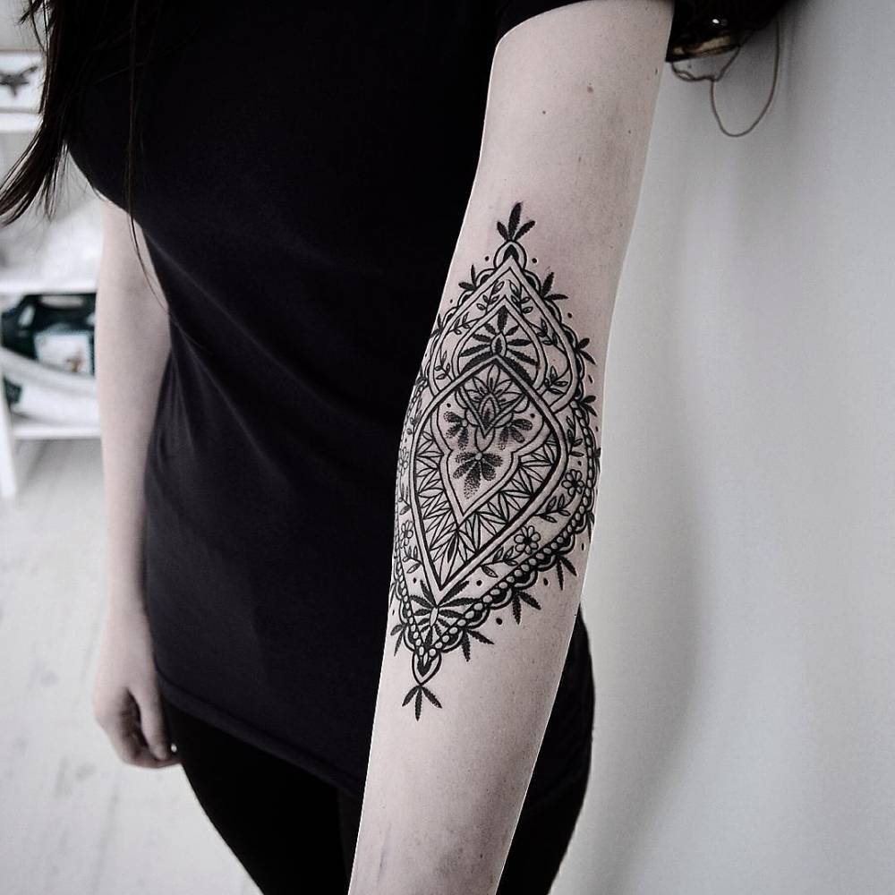 Inner elbow ornamental tattoo
