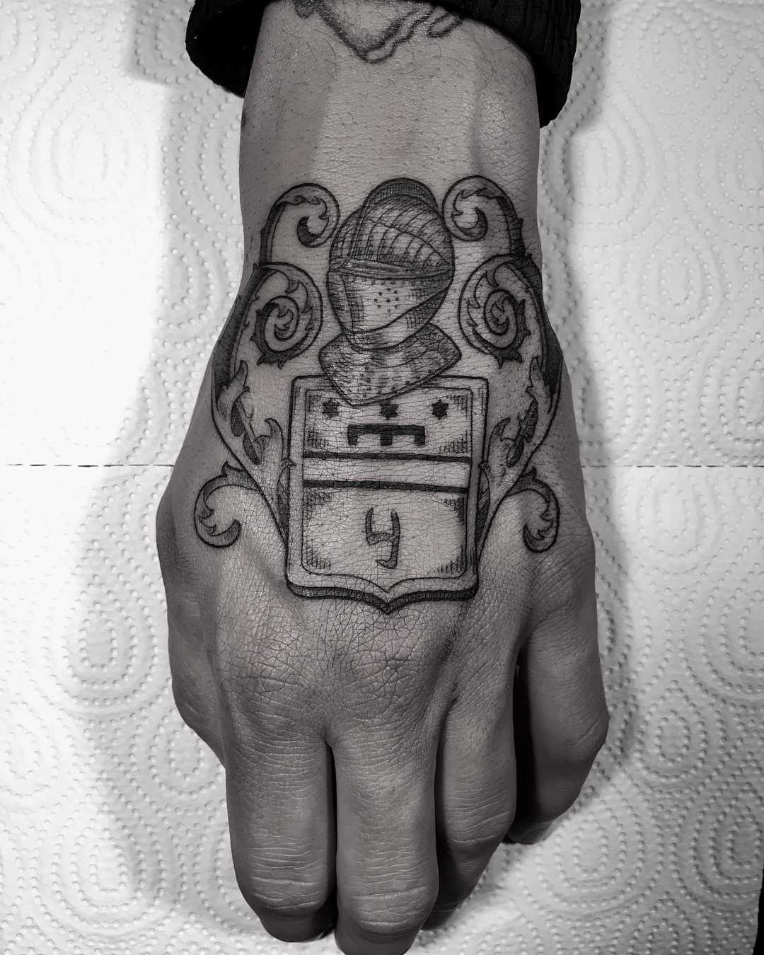 Knight's helmet tattoo