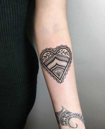 Lace heart tattoo by Matt Stopps