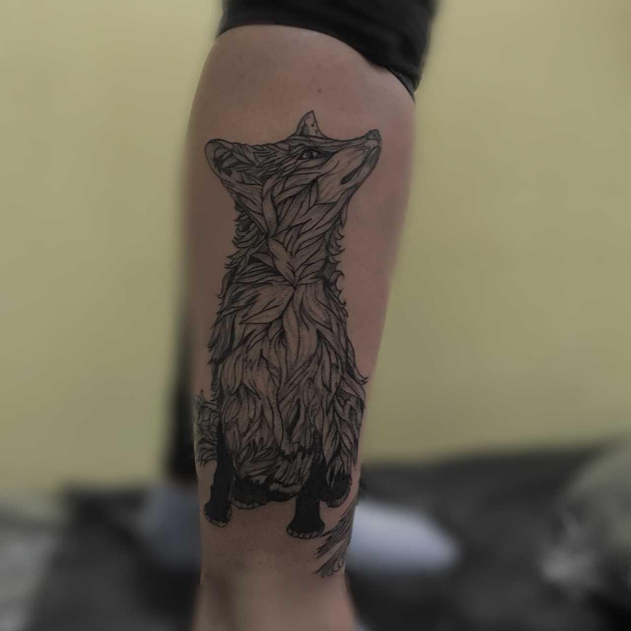 Leafy fox tattoo