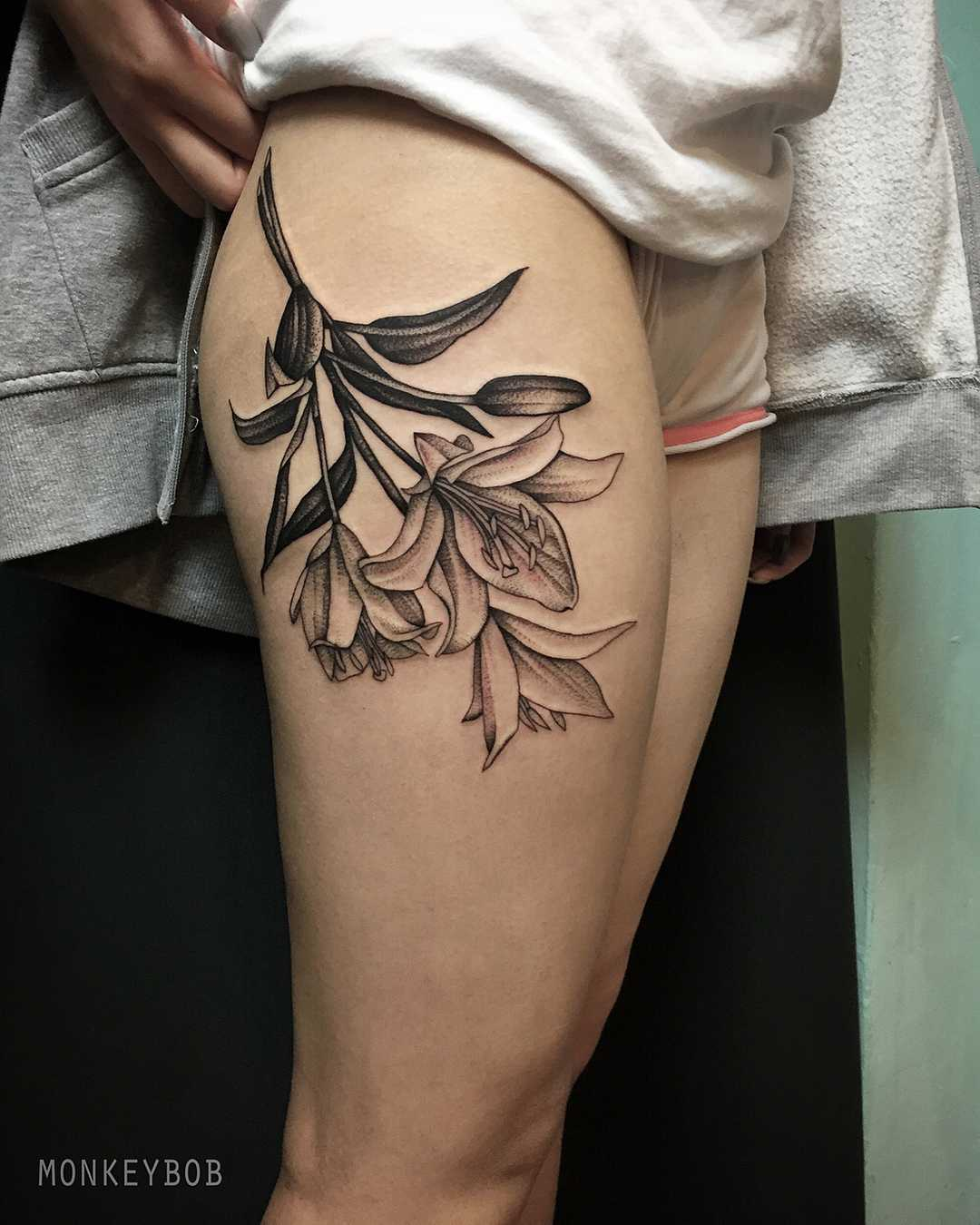 Lillies tattoo on the thigh