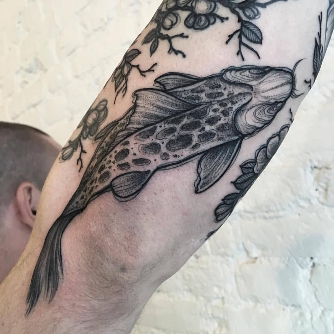 Linework fish tattoo by Sasha Kiseleva