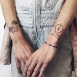 Little wrist shield tattoos
