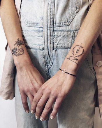Little wrist shield tattoos