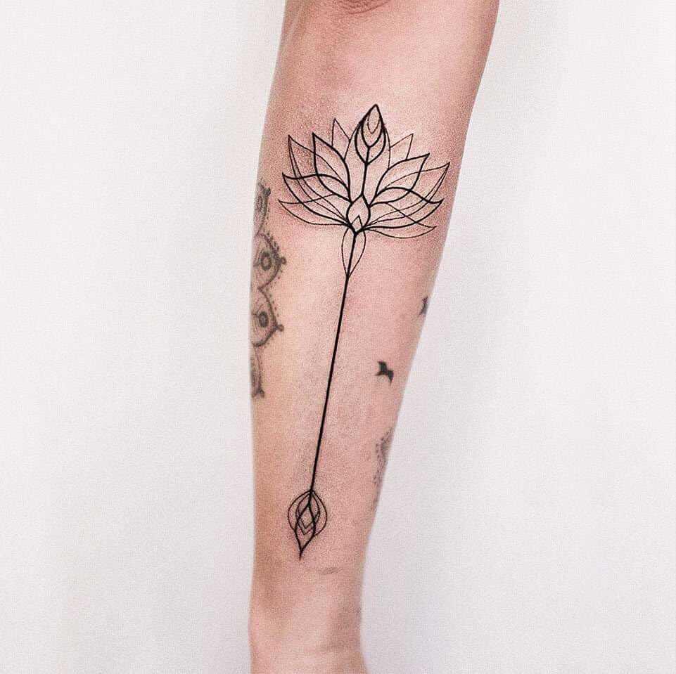 Lotus arrow tattoo by Dogma Noir