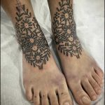 Matching ornament tattoos by Bastien Jean