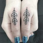 Matching thumb tattoos by Angie Noir