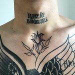 Minimal flower tattoo on chest