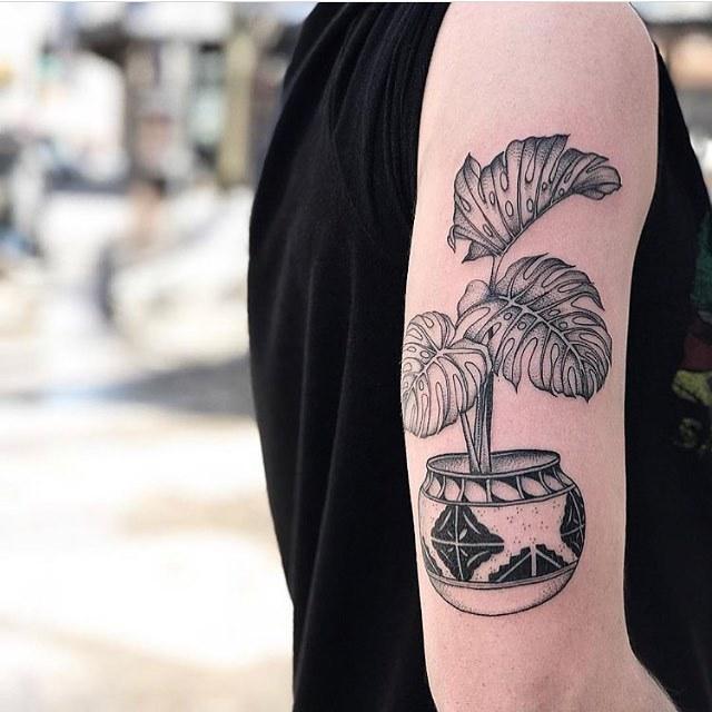Monstera pot tattoo on the arm