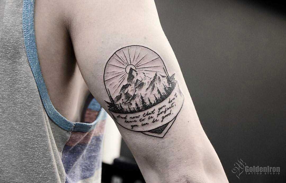 Mountain and quote tattoo by Andrew Szkotti