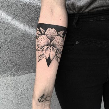 Negative space flower on the forearm