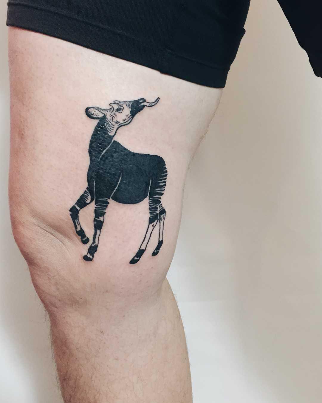 Okapi tattoo on the thigh