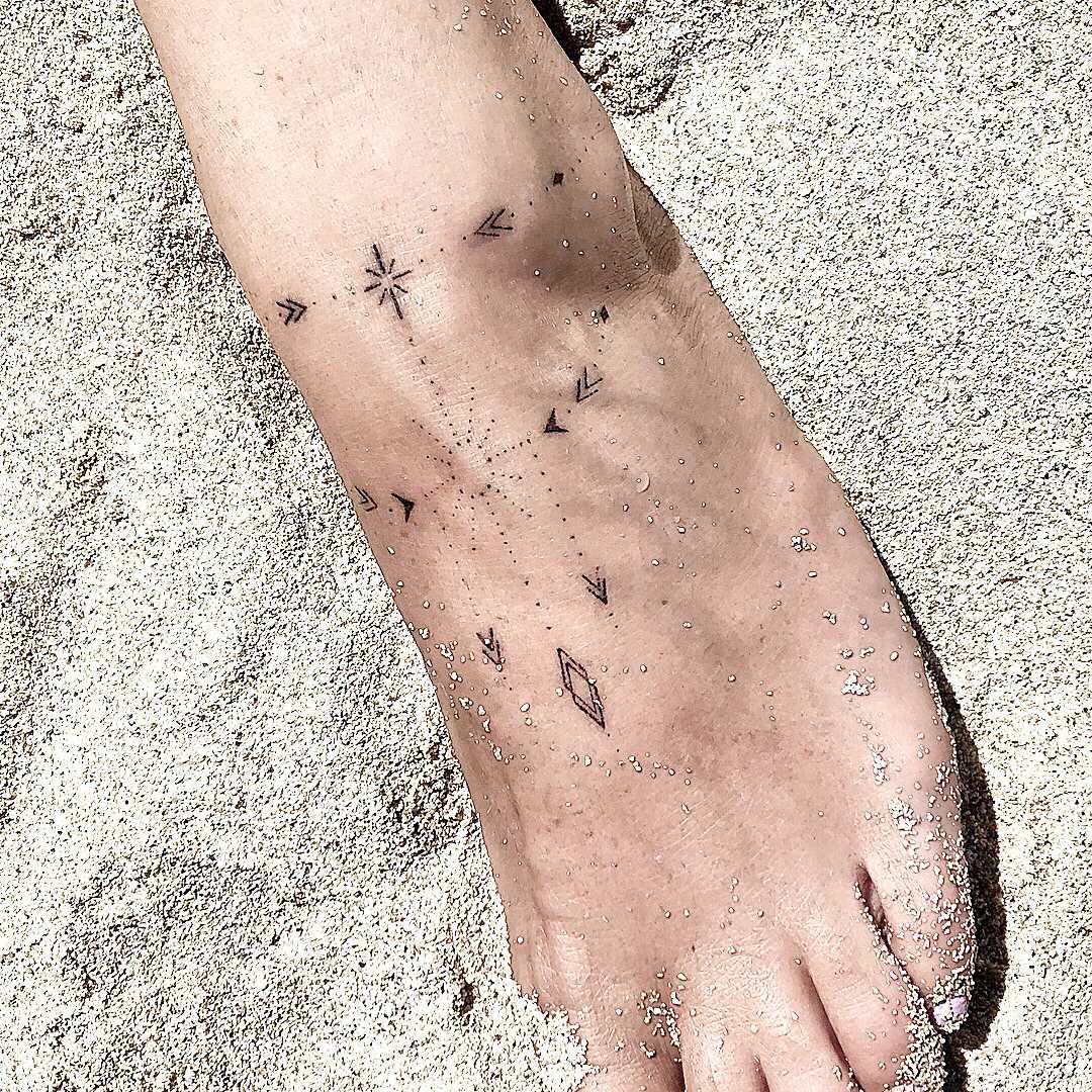 Ornamental tattoo on the foot