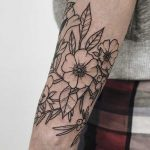 Outline flowers on the forearm