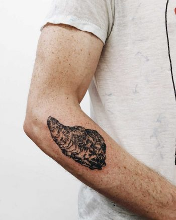Oyster tattoo on the forearm