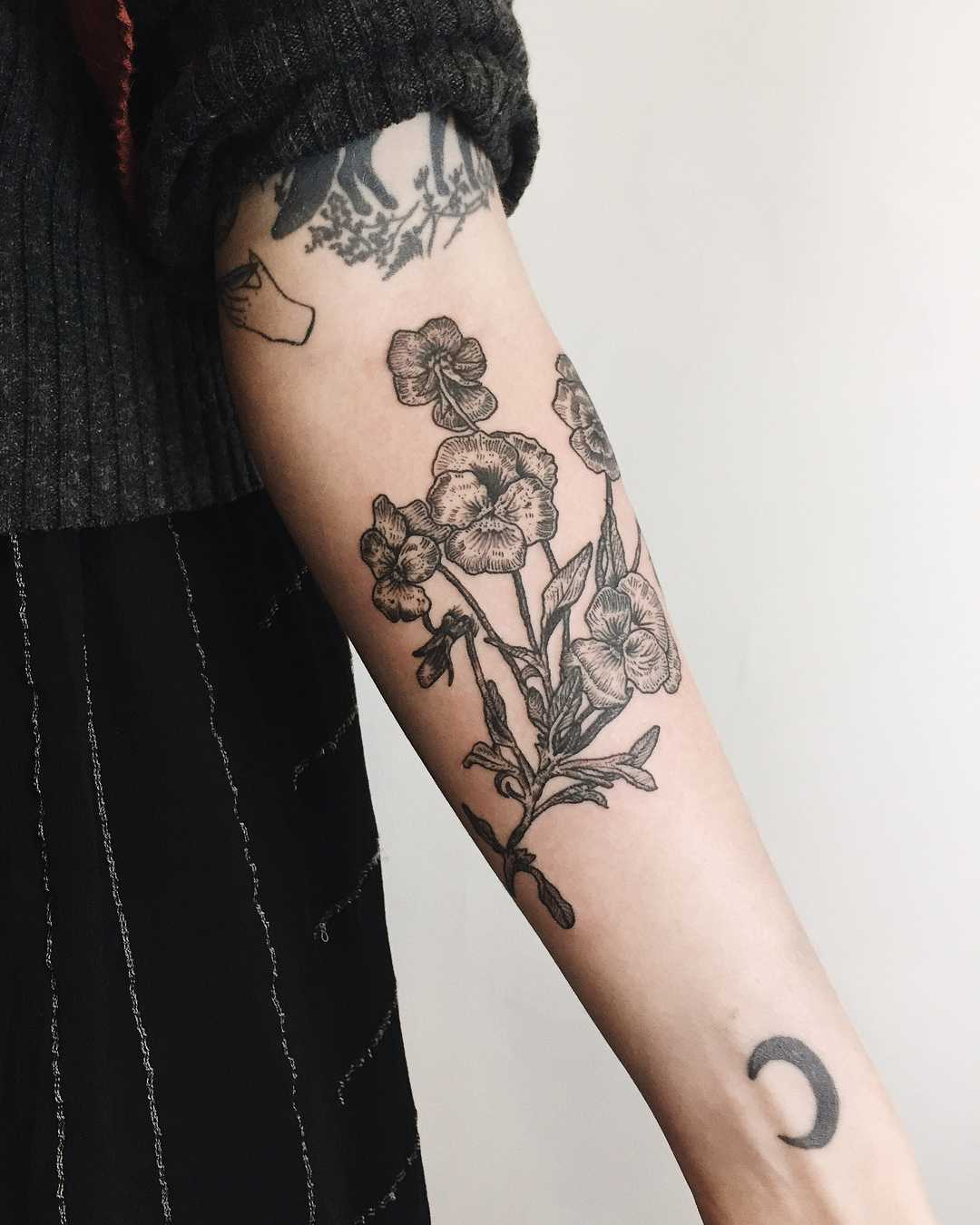Pansies tattoo on the forearm