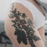Passion flower, oak clover, fern, and sea buckthorn tattoo