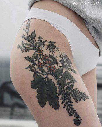 Passion flower, oak clover, fern, and sea buckthorn tattoo