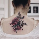 Peonies, fern, blueberry, and wild vetch tattoo