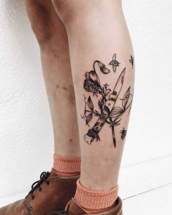 Pocketknife and flowers tattoo