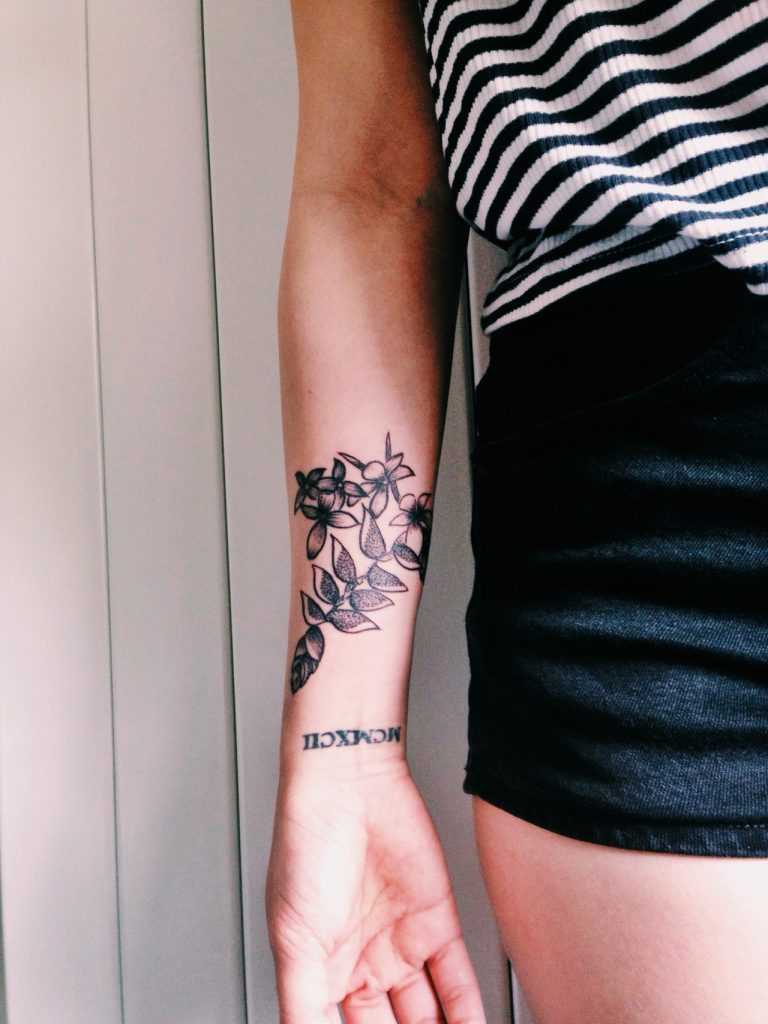 Posy of native malaysian flowers tattoo