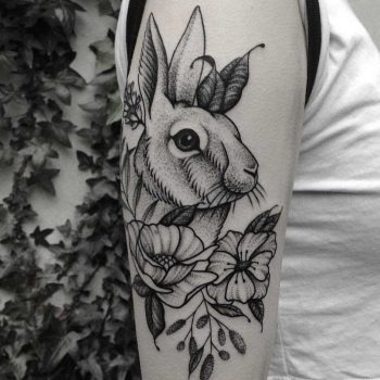 Rabbit and flowers tattoo by Roald Vd Broek