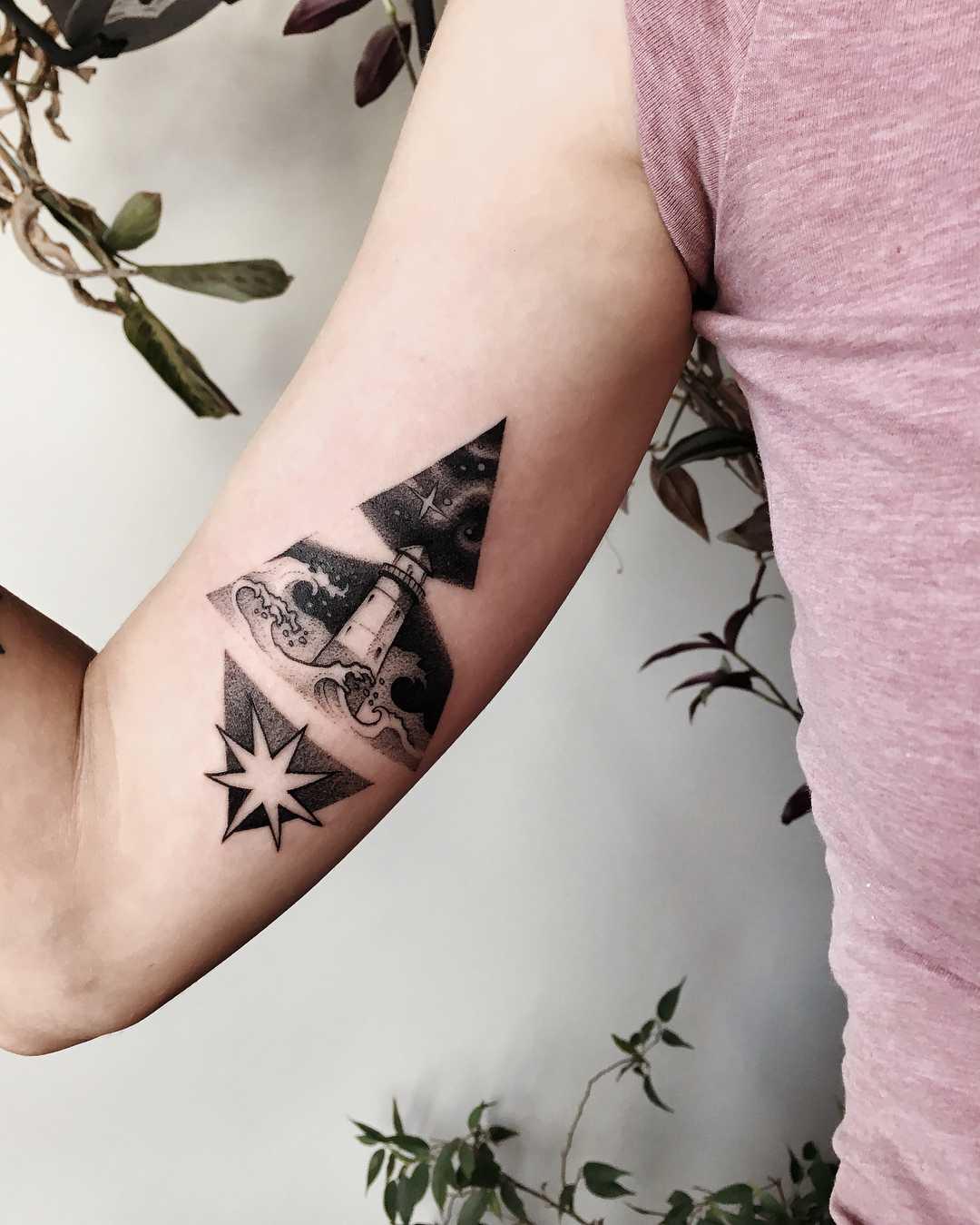 Lighthouse tattoo by Sasha Kiseleva