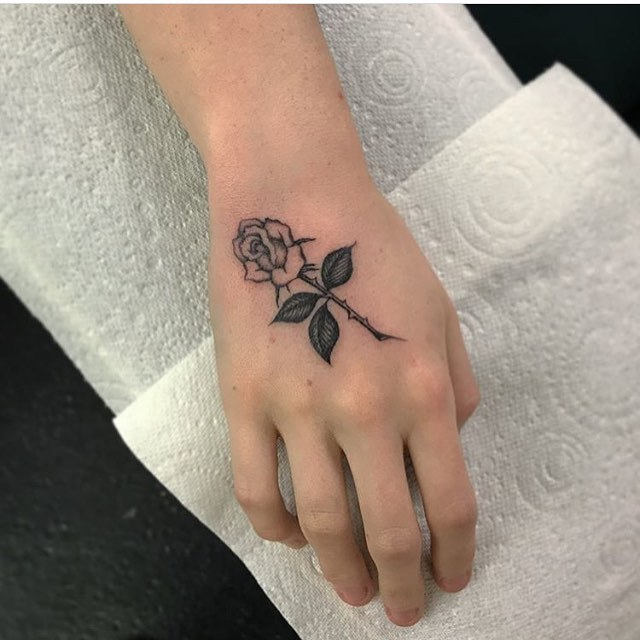Rose tattoo by Ed Mosley