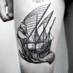 Ship in a hand tattoo