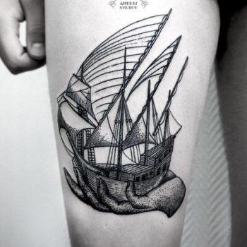 Ship in a hand tattoo
