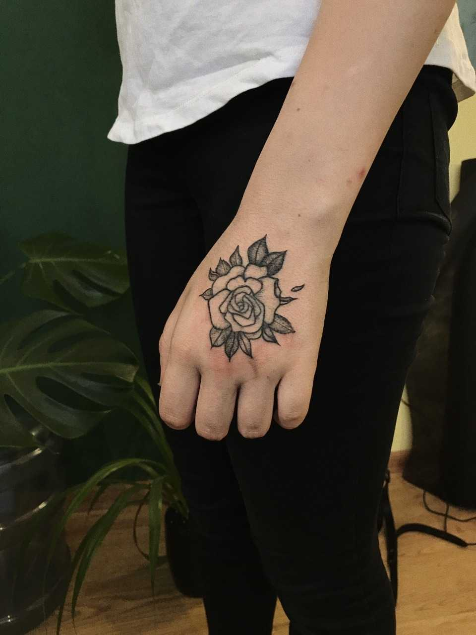 Simple rose tattoo on the left hand