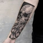 Skull with tulips tattoo