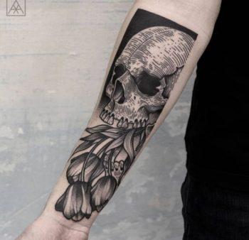 Skull with tulips tattoo