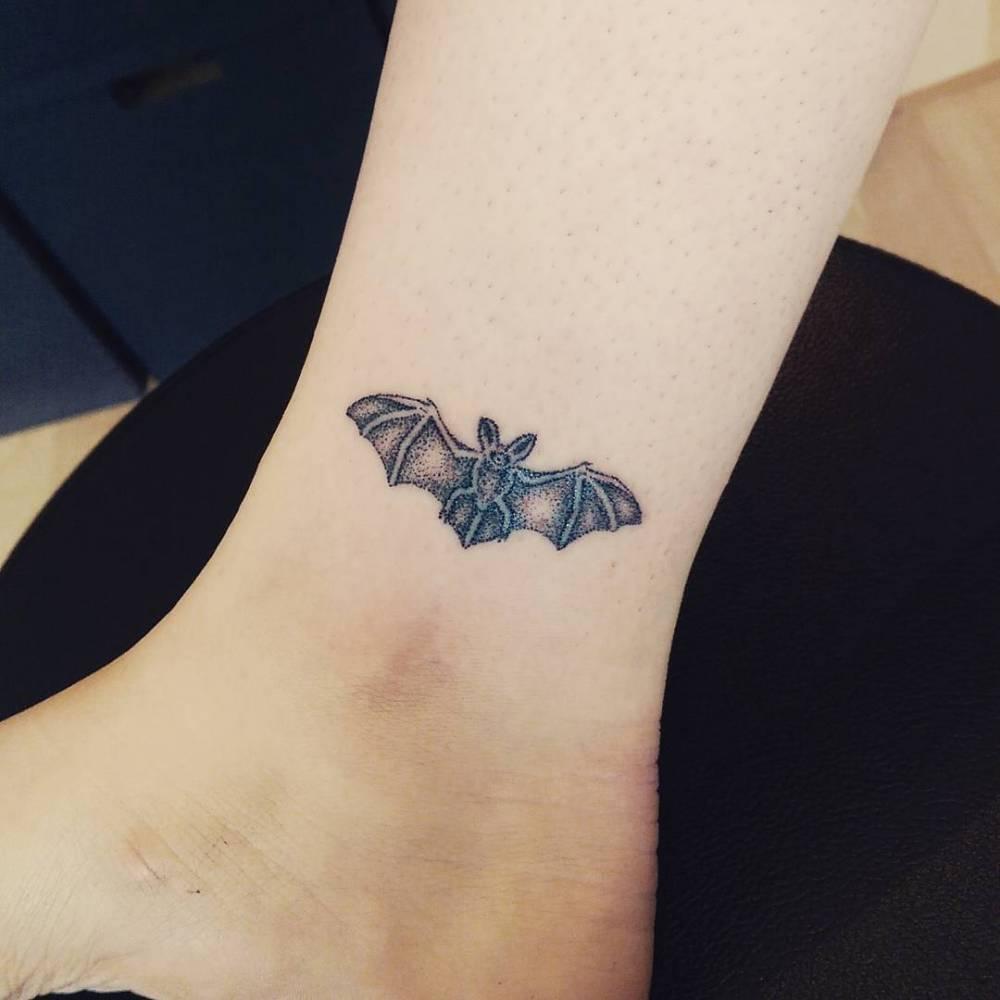 Small hand-poked bat tattoo
