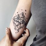 Small mountain tattoo by Sasha Kiseleva