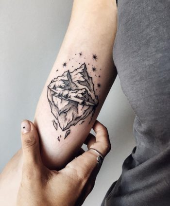 Small mountain tattoo by Sasha Kiseleva