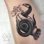 Snake handler's tattoo