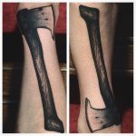 Solid blackwork ax tattoo