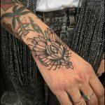 Stylized flower tattoo by Bastien Jean