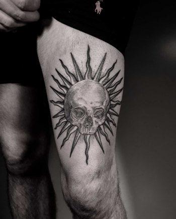 Sun and skull tattoo