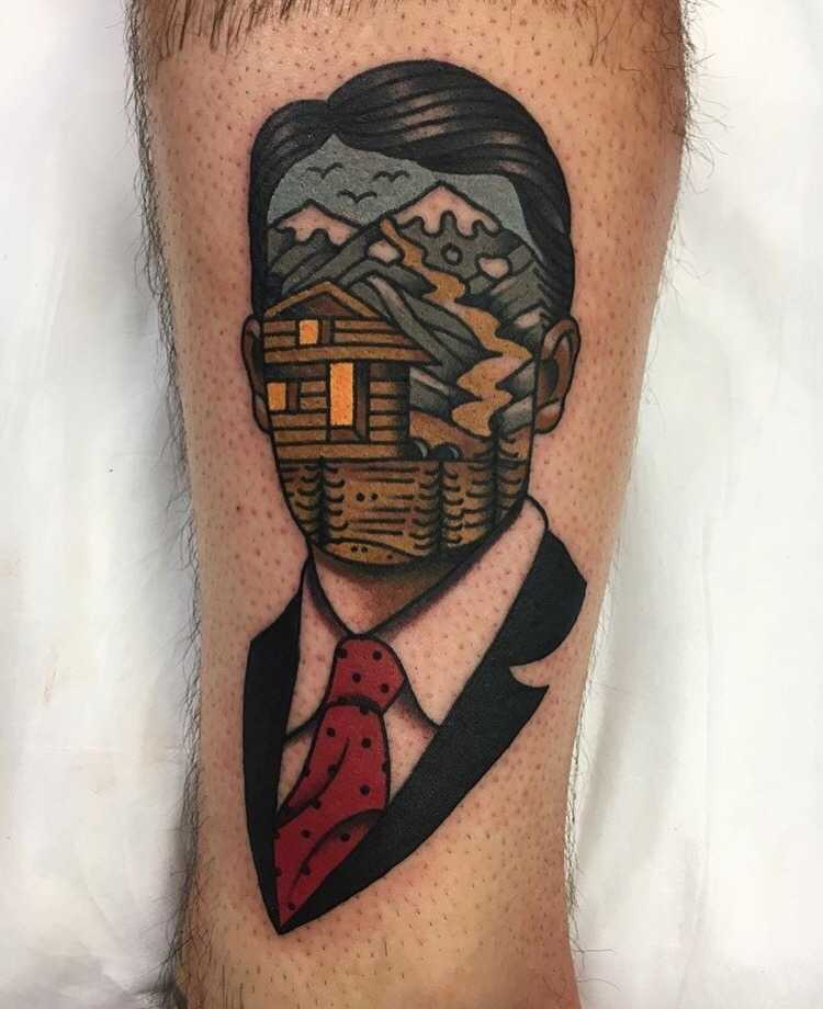 Surrealist man and landscape tattoo by Aaron Ashworth