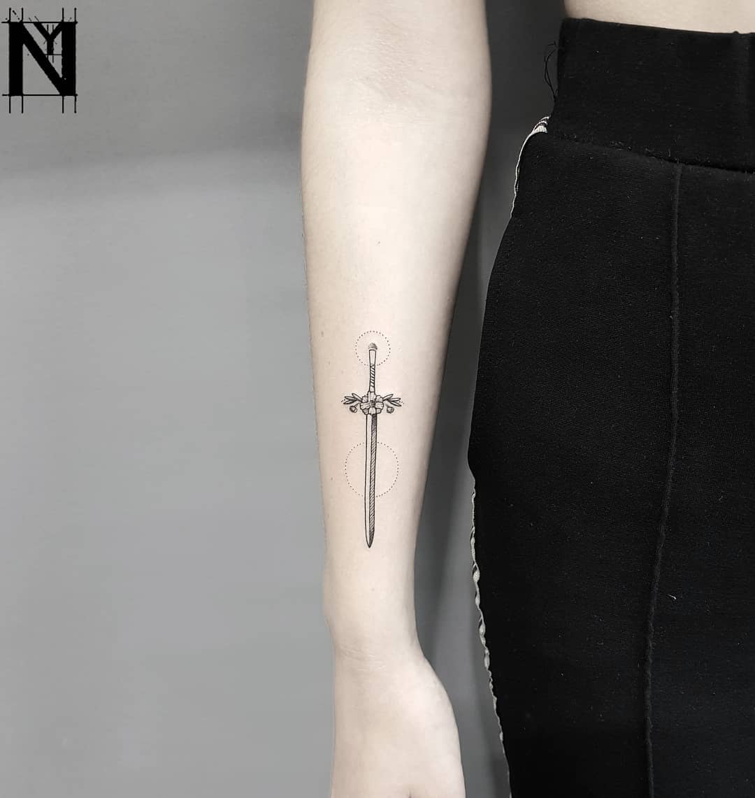 Tiny sword tattoo by Nadav Abras