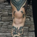 Traditional tattoos on the shin and thigh