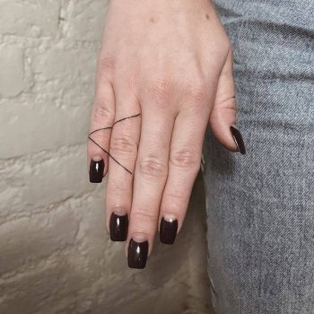 Triangle tattoo on the fingers by Ann Pokes